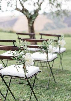 Foliage + bloom chair aisle decor