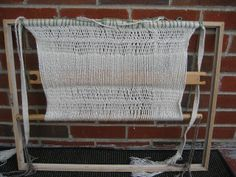 Ravelry: brighthughes' Bog hood.  Sprang loom improvised from a picture frame and dowel rod.