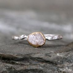 Raw and nature inspired...this twig style ring features a natural raw uncut rough diamond bezel set in 14K yellow gold on a sterling silver band