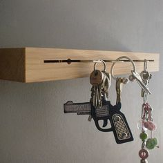 Marvelous Key Rack - designed by Tomke Biallas and Grisella Kreiterling it is a beautifully simply slab of oak – not quite 38 x 6 x 5 cm – only treated with natural oil, that needs to be attached to a wall of your choice. Simply stick your keys into the cut. Your mail goes right on top, or your notes, or your wallet.