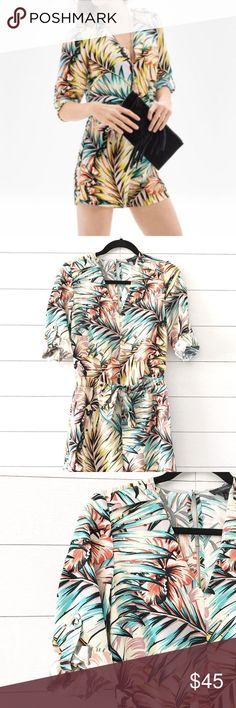 "The Limited V-Neck Floral Print Tropical Romper The Limited romper in excellent condition - however minor snag at back shoulder (shown in last pic, hardly noticeable).  Epaulet buttoned shoulders. Keyhole back with button at top. V-neck, 3/4 sleeve that can be rolled up. Elastic waist with tie. No pockets.  Fabric: 100% polyester Length: 32"" Chest: 18"" Inseam: 4"" The Limited Pants Jumpsuits & Rompers"