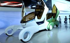 Guests examine a concept car from Chinese carmaker Chery on display at the Auto China 2012 exhibition in Beijing