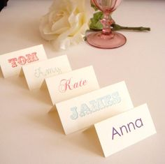 multi colour and font vintage style name cards on ivory linen card stock