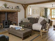 Cosy country living room  If you like this pin, why not head on over to get similar inspiration and join our FREE home design resource library at www.FlorenceAndFreya.com?