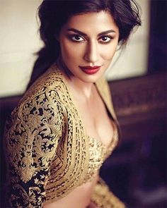 Chitrangada Singh showing off her dusky skin, chiseled jawline and flawless bronze makeup in the most divine Bridal lehengas by Rimple and Harpreet Narula for L'Officiel India January 2016 magazine