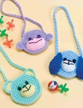 Itty-bitty purses for children. They look quite easy to crochet even without the proper pattern.