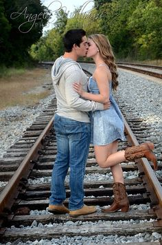 Couple photo idea.  I'm doing a train track session this week.  Will have to keep this in mind.  Maybe without the cheesy leg kick.