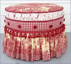 Red and white ottoman.  Multiple fabric inspiration.