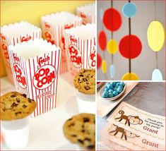 A Curious George Inspired Birthday Party - I love the felt garlands, milk topped with a cookie, and little popcorn boxes.