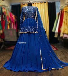 Blue mirrorwork and sequin work peplum Lehenga – Ricco India Party Wear Indian Dresses, Indian Wedding Gowns, Designer Party Wear Dresses, Indian Gowns Dresses, Dress Indian Style, Wedding Dresses For Girls, Indian Designer Outfits, Indian Outfits, Bridal Dresses