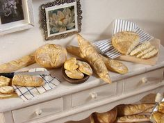 Miniature loaves of bread, looking powdery and fresh from the bakery, by PetitPlat.