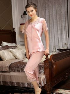 Soft and relaxing, the short sleeves silk pajamas are made of 100% Mulberry silk with a beautiful lace trim at the modern neckline and cuffs. The cropped length pants have an elastic waist with lace edges.  #silk pajamas #LightPink
