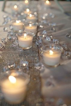 Neat White table cloths with gold runner and tealights and diamond or gold glitter candle scatters. Pretty and simple and inexpensive. The post White table cloths with gold runner and tealights and diamond or gold glitter ca… appeared first on 99 Decor . Diamond Theme, Diamond Party, Diamond Wedding Theme, Winter Wonderland Centerpieces, Winter Wonderland Wedding, Wonderland Party, Wedding Centerpieces, Wedding Table, Diy Wedding