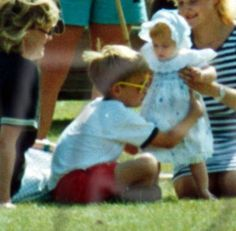 Prince William playing with baby Princess Beatrice