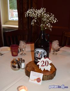Beer growlers and leaves formed the centerpieces for this autumn wedding. Beer Bottle Centerpieces, Fall Wedding Centerpieces, Table Centerpieces, Wedding Decorations, Table Decorations, Wedding Dj, Wedding Stuff, Wedding Flowers, Wedding Ideas