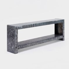 A collection of designs made from laser-cut hot dip galvanized steel. Large, at an industrial kind of scale, they are constructed with large oversized nuts and bolts. Each shelf has been hand finished, utilizing hydrochloric acid to strip back some of the zinc, creating a mottled finish, almost like camouflage. Despite their scale and apparent