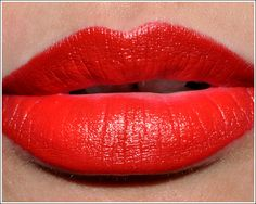 An essential for your makeup collection! Mac Russian Red Lipstick, has a matte finish and makes your lips look awesome!! Goes with every skin tone!