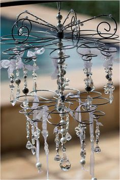 Chandelier made of inverted metal cup-cake stand and crystals - clever