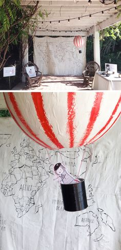 A Midsummer Mingle: Tiny Traveler Tilda map where guest pinned flags of where they wanted to see her go. Flying paper mache hot air balloon by Mer Mag