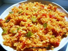 Bulgur wheat pilaf with onions, tomatoes and peppers. Use brown rice for glutards.