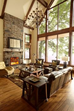 rustic family room by Parkyn Design. Whole bunch of rustic spaces and they are all predominantly wood w a version of white walls. Would really work in our house I think.