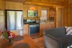 ESCAPE, an RV disguised as cabin. Canoe Bay resort in Wisconsin. Kitchen. Living room. Fridge. Stove. Microwave.