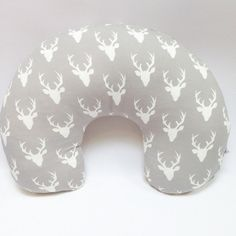 http://www.genderneutralbabyclothes.com/category/nursing-pillow/ Antler Nursing Pillow