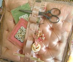 Pink Tufted Satin Inside Lid of a Vintage Sewing Basket With Pins, Scissors, Button Cards, Ivory Rings, & Flowers