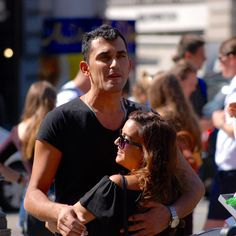 Do you want to dance?#piccadillycircus #streetshot #london #londonlife #handsome #nikon #d80 #nikonphotography #photography #tourist #tourism #candid #candidportrait #travel #sunnyday #hair #background #iphone #sunglasses #dance #dancing #couple #fun #smile #streetphotography #beautiful #beauty