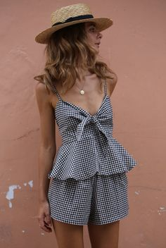 Tie front feature Peplum flare Shirred back for fit Adjustable straps Stripe/Gingham 100% Cotton    White 100% Linen Model wears XS.