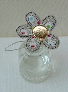 A Beige and Gold Flower in a Bottle  £5.00
