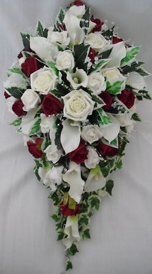 Stunning Brides Bouquet with Ivory Cala Lilies and Burgundy and Ivory Roses  This beautiful Brides Bouquet has been created using only quality