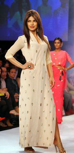 Indian Bollywood actress Priyanka Chopra showcases a creation by designer Neeta Lulla on the sixth day of the Lakme Fashion Week (LFW) summer/resort 2014 in Mumbai on March Indian Bollywood Actress, Bollywood Fashion, Bollywood Images, Lakme Fashion Week, India Fashion, Indian Dresses, Indian Outfits, Actress Priyanka Chopra, Frock Fashion