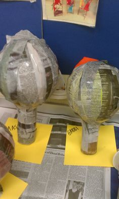 hot air balloons on toilet paper rolls- would take some time but would be fun for Art Club- and could hang them in the room