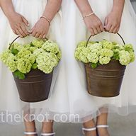 Use buckets with flowers in out door ceremony