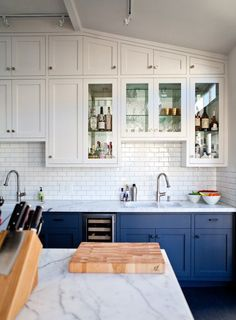I like different colored cabinets on top and bottom. 51bda7e3dbd0cb1fac0021f0._w.540_s.fit_