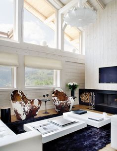 This stylish mountain retreat is located in Megève between the Swiss mountains – a chalet with a traditional exterior and a modern white interior. White wall an Lofts, Living Area, Living Spaces, Living Room, Cowhide Chair, Swivel Chair, Sweet Home, Interior Decorating, Interior Design