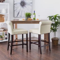 Enjoy these chairs in the kitchen or bar. Featuring low backs for superb lumbar support plus comfortable seats that facilitate long conversations, these Cosmopolitan Cream leather counter stools have sturdy bases and offer lasting style.