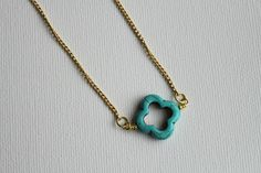 The Delicates - Simple, modern gold plated chain anchored with howlite clover or skull bead.. $35.00, via Etsy.