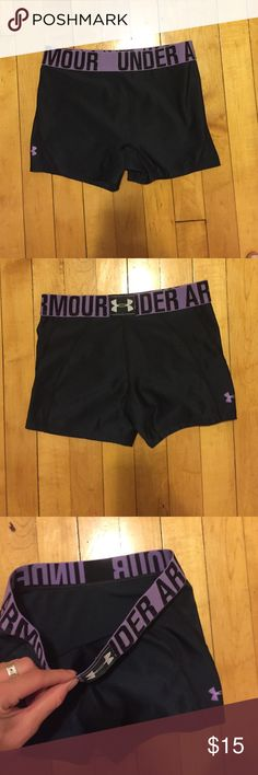 Under Armour Black Spandex Black spandex with purple elastic band and purple under Armour sign on bottom of short. Stretchy and in perfect condition! Under Armour Shorts