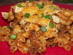 Taco Casserole! Swapped tomato for 1 can Ro-Tel and added 1 can pinto beans and 1 can refried beans.