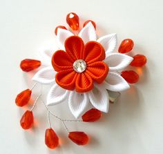 Kanzashi fabric flower hair clip. White and orange fabric by JuLVa