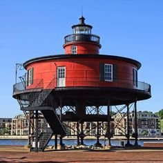 Baltimore Maryland USA. Here on the Inner Harbor waterfront is the Seven Foot Knoll Lighthouse which is a Baltimore landmark with a history that goes back to 1855. The lighthouse is Built entirely of iron in a circular design and is famed for its barn red color. It is Marylands oldest screw pile lighthouse and it is also open to the public.I