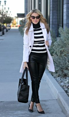 Leather pant, striped sweater, and a white coat