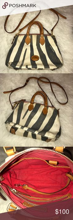 Dooney & Bourke Zebra Canvas Crossbody Purse This is a preloved 100% authentic crossbody canvas zebra Dooney & Bourke Purse. I tried to dry clean but due to leather was not able too. It is actually cute with the worn look on it. Looks so cute on! I was obsessed with it. I never use it anymore and deserves a loving owner who will use it! No trades  Dooney & Bourke Bags Crossbody Bags