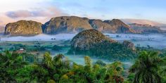 Cool Places to #Travel - Viñales Valley, Cuba seem like a picture out of Southeast #Asia rather than the island of #Cuba.  #roomsninja #traveling #tourism #hotels #mytravelgram #vacation #instagood #travelgram #travelling #instatraveling #experience #instago #passportready #wanderlust #ilovetravel #traveltheworld #igtravel #getaway #instatravelling #instavacation #bucketlistgeneration #travelquote #savemoney #bucketlist #placestogo #traveltips