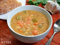 This Slow Cooker White Bean Soup practically makes itself! Just throw everything into the pot and press go to end up with a thick, flavorful, vegan soup. BudgetBytes.com H