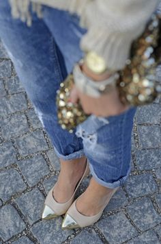 Dashes of gold dress up distressed denim