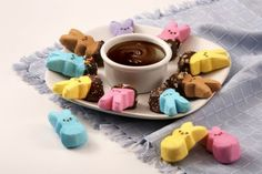 Another easy way to make Peeps even better? Dip them in chocolate! Bonus points for rolling them in tasty toppings like sprinkles and crushed cookies.
