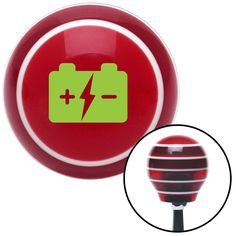Green Battery Charge Symbol Red Stripe Shift Knob with M16 x 15 Insert - Give your interior the ultimate look. American Shifter's Elite(TM) series shift knobs are made from the highest quality components resulting in a superior feel on every shift. Each shift knob is designed and customized in the USA by skilled shift knob artisans who have a trained eye on every detail. American Shifters shift knobs offers an exclusive aluminum threaded insert designed to be screwed onto your shift arm. You…